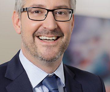 Porträtfotos der Vorstandsmitglieder des Allianz-Tochterunternehmens Euler Hermes